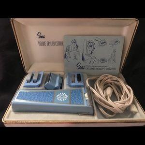 Vintage Sear's women's electric shaving kit.